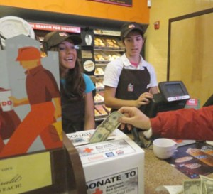 Rhode Islanders donating to the Red Cross relief effort for Hurricane Sandy victims at a Dunkin' Donuts in Cranston.