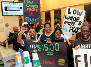 Protesters rally for a higher minimum wage at a Subway sandwich shop in Los Angeles. Franchisees say increasing wages could force them to raise retail prices. Photo: Slobodan Dimitrov