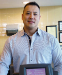 Yuwen Chen and his brother operate a network of Dunkin' Donuts shops in New York's Hudson Valley