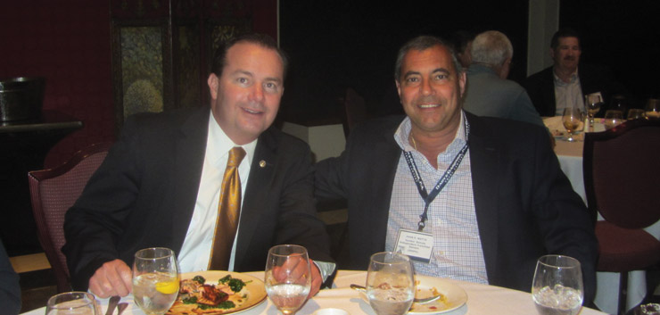 Senator Mike Lee (R-Utah) at lunch with Dunkin' Donuts franchise owner and CFA Director John Motta. Senator Lee, the ranking minority member of the Senate Antitrust, Competition Policy and Consumer Rights Subcommittee, also serves on the Joint Economic Committee.