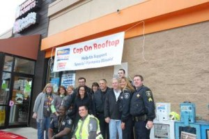 Local police officers stake out Dunkin Donuts to support the Special Olympics